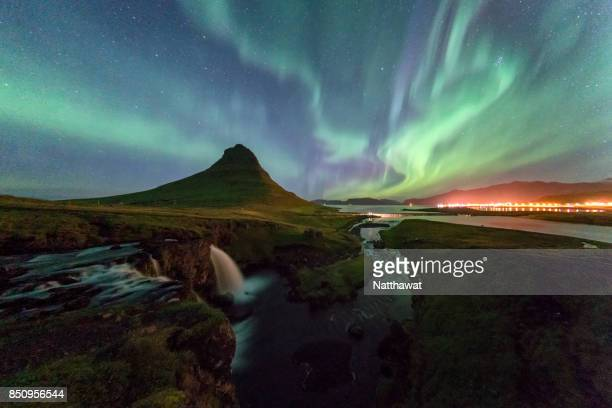 aurora over kirkjufell, iceland - solar flare stock pictures, royalty-free photos & images