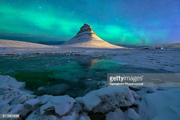 aurora over kirkjufell mountain iceland - color climax stock pictures, royalty-free photos & images