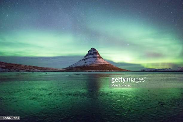aurora over kirkjufell reflection - reflection lake stock photos and pictures