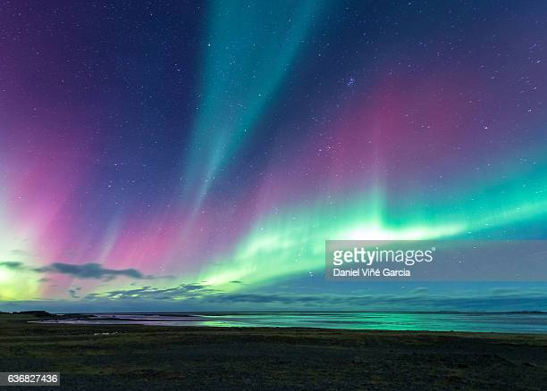 Aurora over sea in Iceland near from Eastfjords