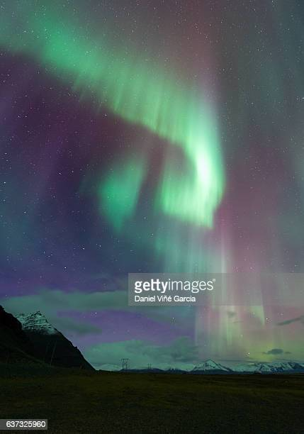 aurora over sea in iceland near from eastfjords - austurland stock pictures, royalty-free photos & images