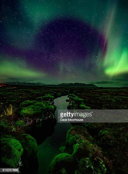 aurora over the silfra rift in iceland - tectonic stock photos and pictures