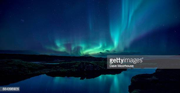 aurora over the silfra rift in iceland - aurora borealis stock pictures, royalty-free photos & images