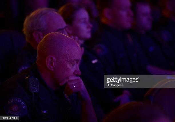 Aurora Police Officer Mike Hawkins a 18 year veteran and first responder to the shooting sits with other Aurora Police officers during the reopening...
