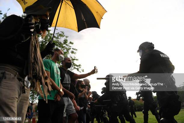 Aurora police officers push back protesters with batons during the Elijah McClain protest at the Aurora Municipal Center June 27 2020 Elijah McClain...