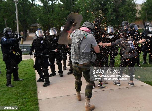 Aurora police officers spray Elijah McClain protesters with pepper spray foam at the Aurora Municipal Center June 27 2020 Elijah McClain died August...