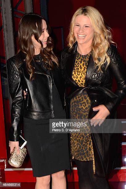 Aurora Ramazzotti and Michelle Hunziker attend the Versace show during the Milan Fashion Week Autumn/Winter 2015 on February 27 2015 in Milan Italy