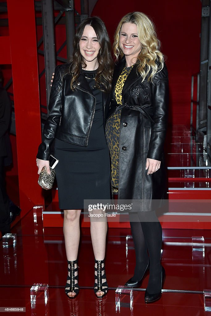 Aurora Ramazzotti and Michelle Hunziker attend the Versace show during the Milan Fashion Week Autumn/Winter 2015 on February 27, 2015 in Milan, Italy.