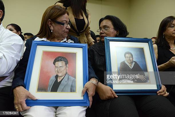 Aurora Rodriguez and Julietta Castellanos mothers of murdered University students Rafael Alejandro Vargas and Carlos David Pineda hold their pictures...