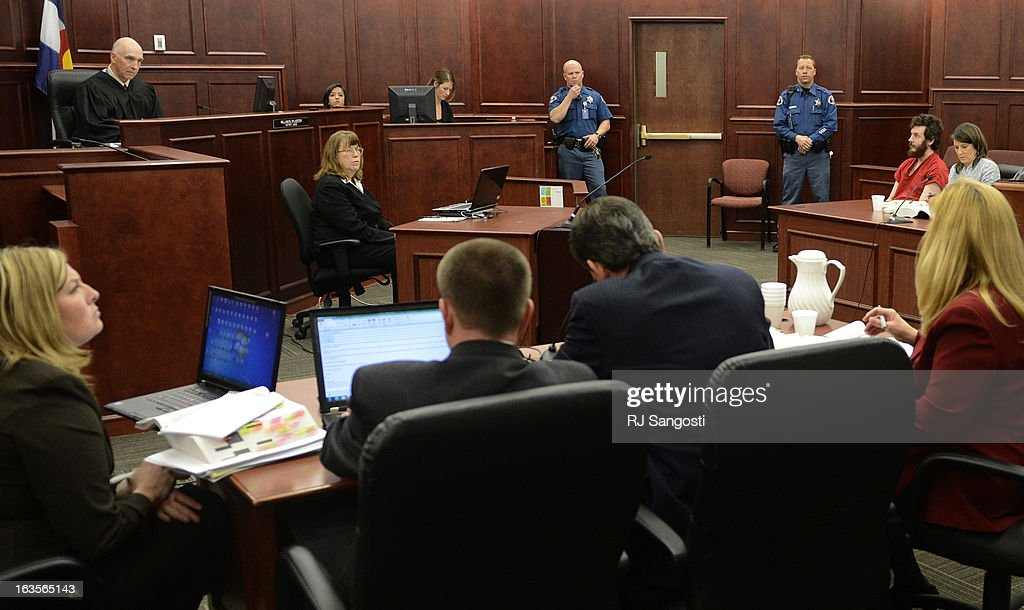 Aurora theater shooting suspect James Holmes in the courtroom during his arraignment, March 12, 2013. District Court Judge William Sylvester entered a Not Guilty plea on behalf of Holmes. The arraignment for Aurora theater shooting suspect James Holmes for the July 20, 2012 shooting at the Century 16 theater in Aurora, CO that killed 12 people and injured 70 others.
