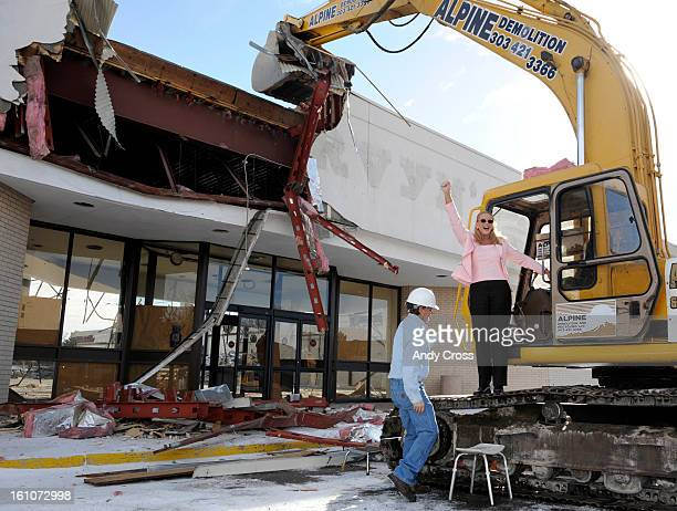 COBUCKINGHAMAurora City Council member Molly Markert celebrates after taking down a part of Mervyn's department store in the old shopping mall...