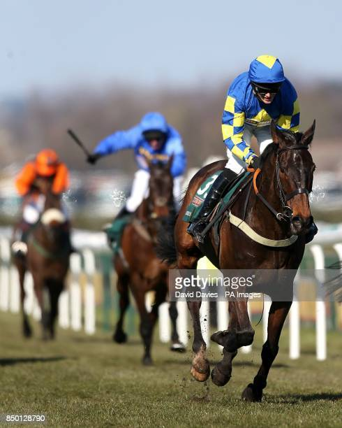 Auroras Encore ridden by jockey Ryan Mania on the way to victory the John Smith's Grand National Chase during Grand National Day at Aintree...