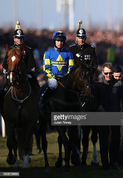 Auroras Encore ridden by Ryan Mania after winning the John Smiths Grand National at Aintree Racecourse on April 6, 2013 in Liverpool, England.
