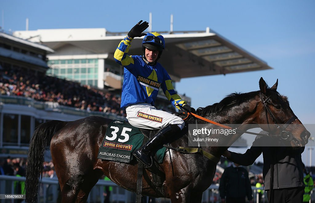 Auroras Encore ridden by Ryan Mania celebrates winning the John Smiths Grand National at Aintree Racecourse on April 6, 2013 in Liverpool, England.