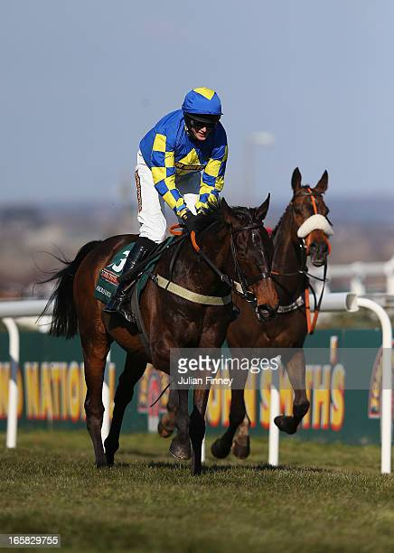 Auroras Encore ridden by Ryan Mania on their way to winning the John Smiths Grand National at Aintree Racecourse on April 6, 2013 in Liverpool,...