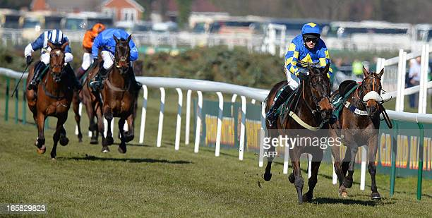 Auroras Encore ridden by Ryan Mania wins the Grand National horse race at Aintree Racecourse in Liverpool, north-west England, on April 6, 2013. The...