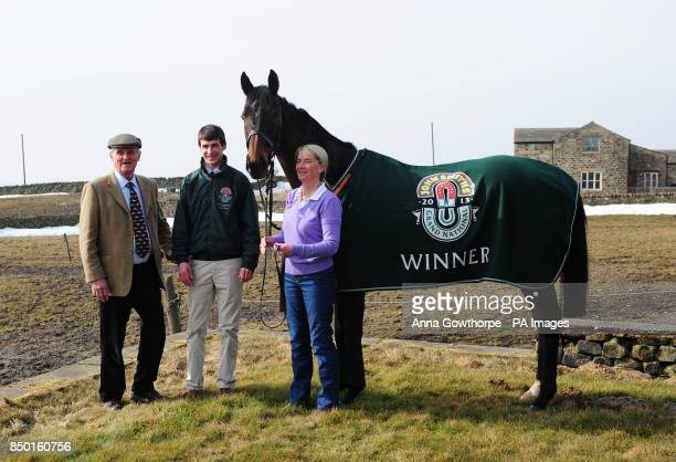 Auroras Encore with trainers Harvey and Sue Smith and winning jockey Ryan Mania during the winners photocall at Craiglands Farm, Bingley.