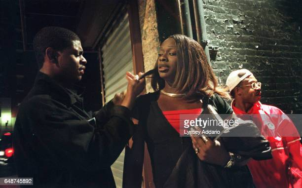 Aurora's friend brushes her hair while her exboyfriend Muhammed right watches for cops in the West Village of New York City on May 16 1999