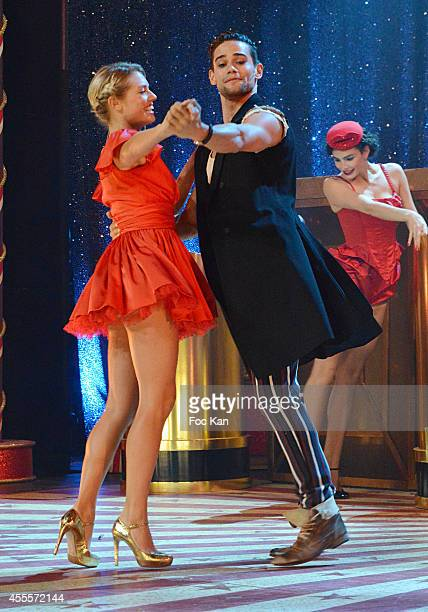 Aurore Delplace and Golan Yosef perform during the 'Love Circus' Press Preview At the Folies Bergeres on September on September 16 2014 in Paris...