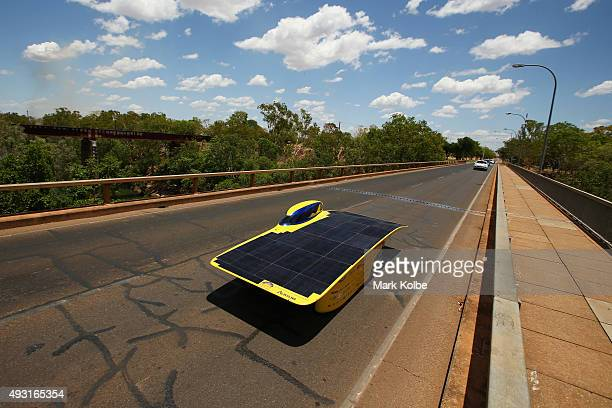 Aurum of University of Michigan Solar Car Team USA crosses the Katherine river as it races in the Challenger Class during day one of the 2015 World...