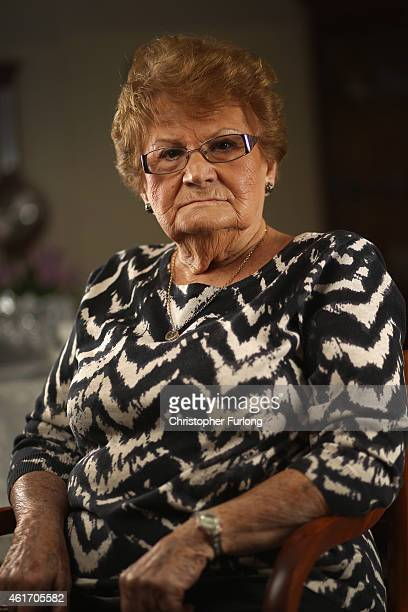 Auschwitz and Belsen concentration camp survivor Eva Behar poses in her home on December 1 2014 in London United Kingdom As the Russians approached...
