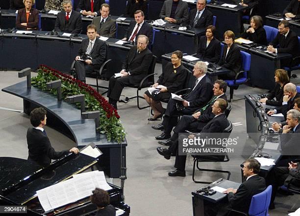 Auschwitz survivor and former European Parliament President Simone Veil sits between Bundestag speaker Wolfgang Thierse and German President Johannes...