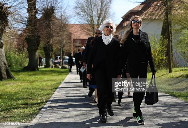 Auschwitz survivor and one of the plaintiffs Eva PusztaiFahidi and her granddaughter Luca Hartai arrive at the court after a break of the trial...