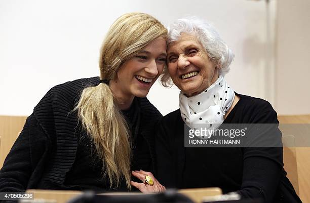 Auschwitz survivor and plaintiff Eva Pusztai-Fahidi and her granddaughter Luca Hartai wait for the begining of a trial of former Nazi death camp...