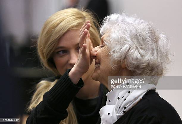 Auschwitz survivor and plaintiff Eva PusztaiFahidi and her granddaughter Luca Hartai wait for the begining of a trial of former Nazi death camp...