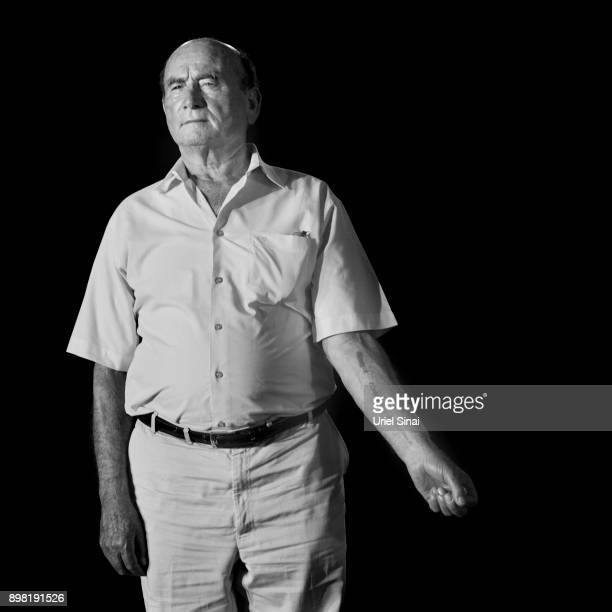 B14671 Auschwitz survivor David Leitner is photographed on August 01 2011 in Ramat Gan Israel He was tattooed with # B14671 from the Auschwitz...