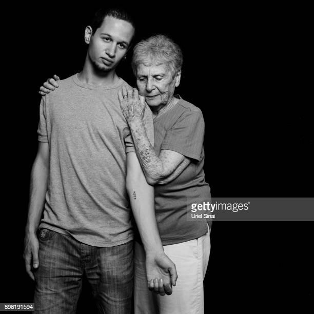 4559 Auschwitz survivor Livia Ravek is photographed with her Grandson Daniel Philosoph on August 31 2012 in Bnei Zion Israel She was tattooed with...