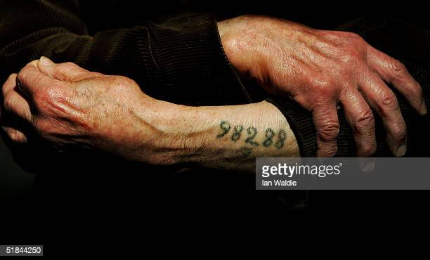 Auschwitz survivor Mr. Leon Greenman, prison number 98288, displays his number tattoo on December 9, 2004 at the Jewish Museum in London, England....