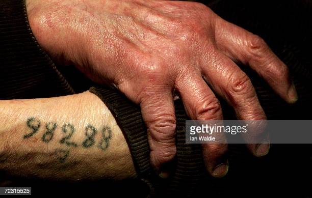 Auschwitz survivor Mr Leon Greenman prison number 98288 displays his number tattoo on December 9 2004 at the Jewish Museum in London England Mr...