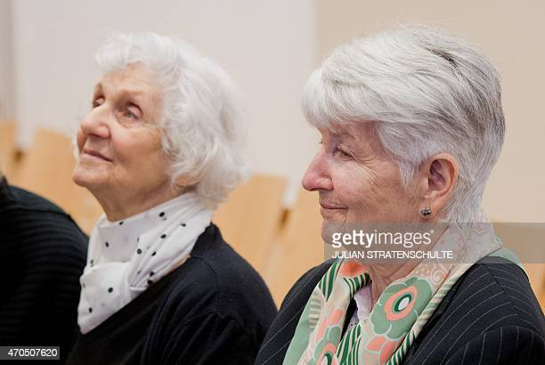 Auschwitz survivors and plaintiffs Hedy Bohm and Eva PusztaiFahidi attend the trial of former Nazi death camp officer Oskar Groening on April 21 2015...