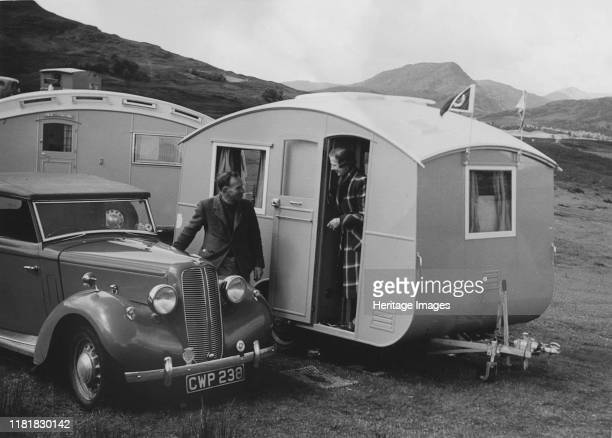 Ausin Big Seven tourer with caravans Creator Unknown