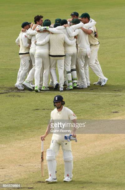 Ausralia celebrate after Pat Cummins of Australia claimed the final wicket of Chris Woakes of England to claim victory during day five of the Third...