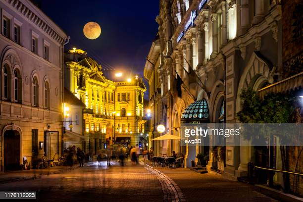ausros vartu street in the old town of vilnius by night, lithuania - lithuania stock pictures, royalty-free photos & images