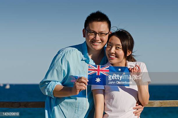 Aussie Asian couple with Australian flag