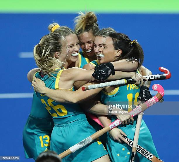 Austalia celebrate their victory during the Women's Pool B hockey match between Australia and Japan on Day 8 of the Rio 2016 Olympic Games at the...