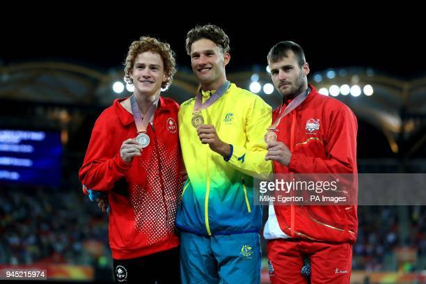 Austalia's Kurtis Marschall Canada's Shawnacy Barber and England's Luke Cutts celebrate with their gold silver and bronze medals respectively in the...
