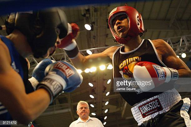 Austerberto Juarez punches Rick Lopez during bout of the United States Olympic Team Boxing Trials at Battle Arena on February 19 2004 in Tunica...