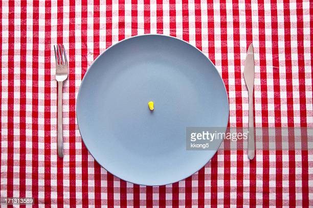 austere food: modern blue plate on checkered tablecloth - scarce stock pictures, royalty-free photos & images