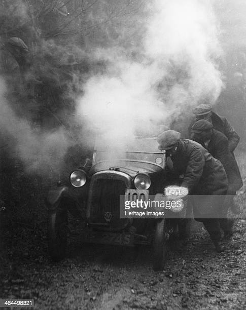 Austin 7 Gordon England cup at the Exeter trial Steam pours out from under the bonnet of the car