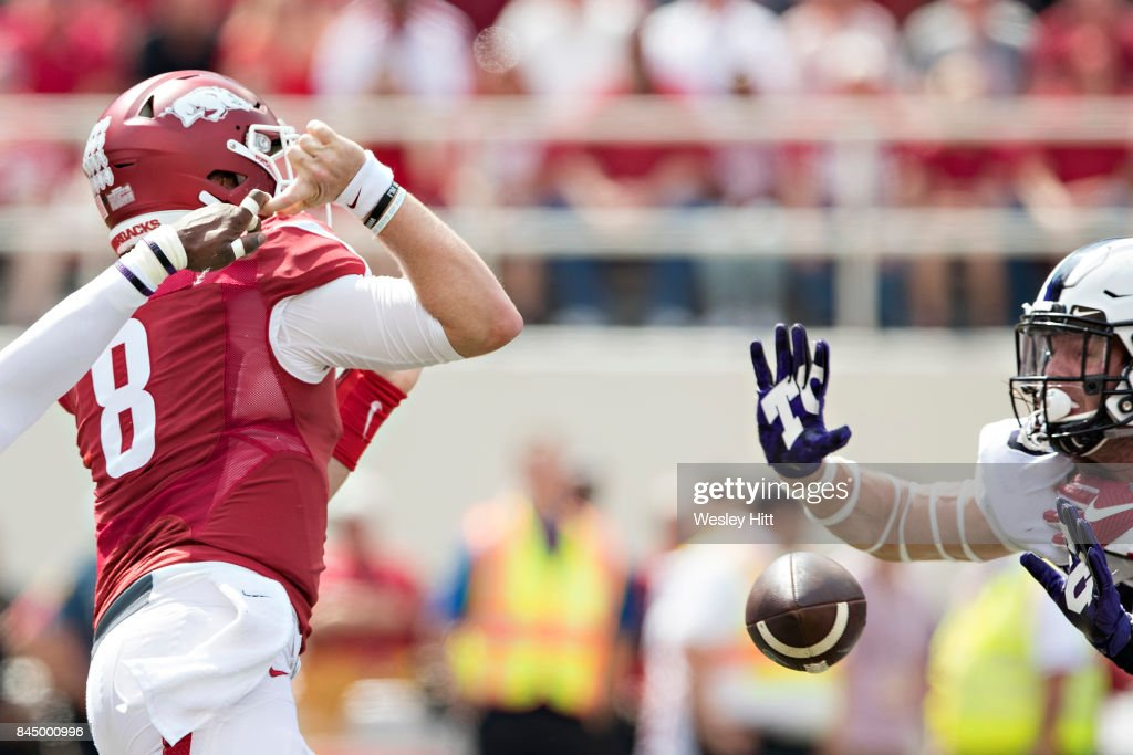 Austin Allen #8 of the Arkansas Razorbacks has a pass knocked out of his hands during a game against the TCU Horned Frogs at Donald W. Reynolds Razorback Stadium on September 9, 2017 in Fayetteville, Arkansas.