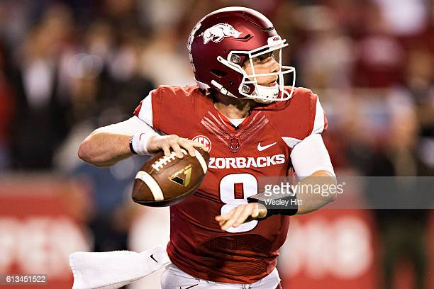 Austin Allen of the Arkansas Razorbacks throws a pass during a game against the Alabama Crimson Tide at Razorback Stadium on October 8 2016 in...