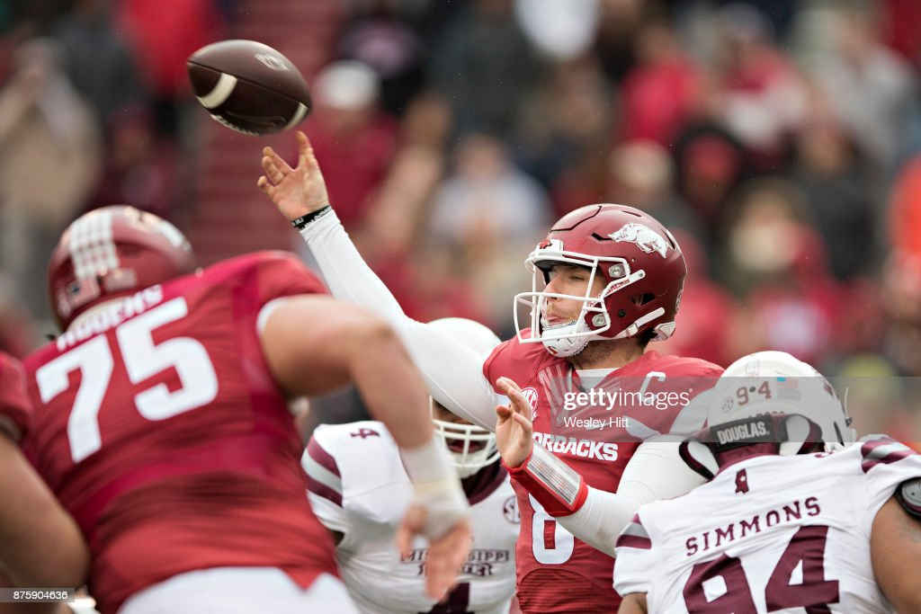 Austin Allen #8 of the Arkansas Razorbacks throws a pass from the pocket during a game against the Mississippi State Bulldogs at Razorback Stadium on November 18, 2017 in Fayetteville, Arkansas. The Bulldogs defeated the Razorbacks 28-21.