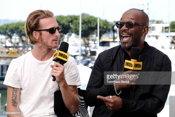 Austin Amelio and Lennie James speak onstage at the #IMDboat at San Diego Comic-Con 2019: Day Two at the IMDb Yacht on July 19, 2019 in San Diego,...