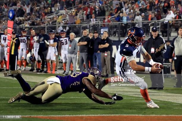 Austin Appleby of Orlando Apollos scrambles with the ball against Brandon Watts of Atlanta Legends during the fourth quarter on February 09 2019 in...