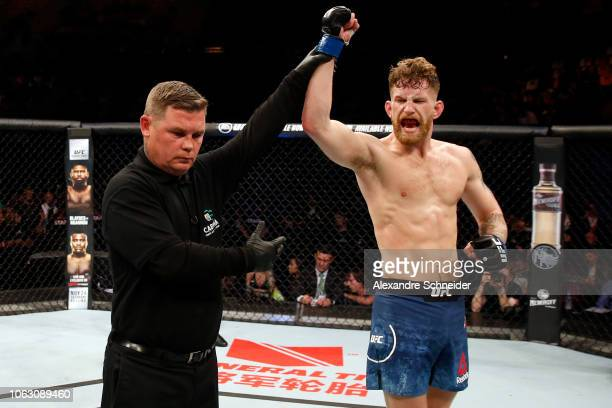 Austin Arnett celebrates after defeating Humberto Bandenay of Peru in their featherweight bout during the UFC Fight Night event inside Arena Parque...