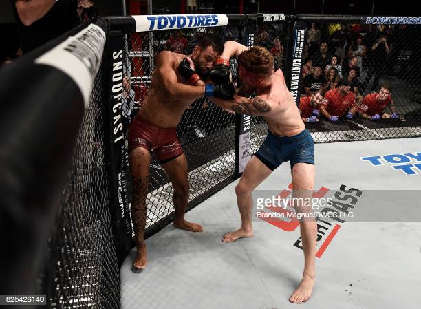 Austin Arnett elbows Brandon Davis in their featherweight bout during Dana White's Tuesday Night Contender Series at the TUF Gym on August 1 2017 in...